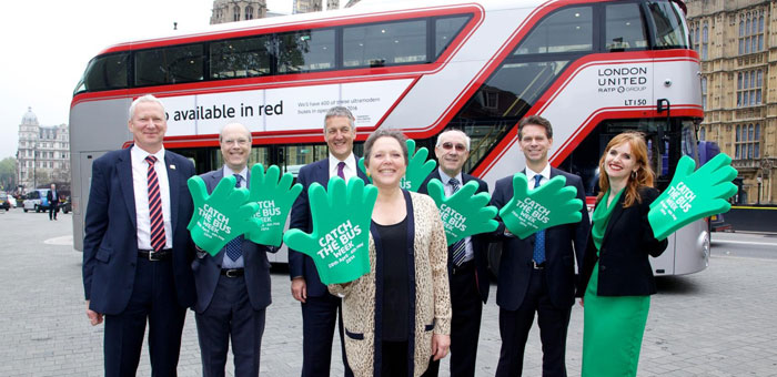 Baroness Kramer, Claire Haigh and Bus company MD's in front of a silver Routemaster bus
